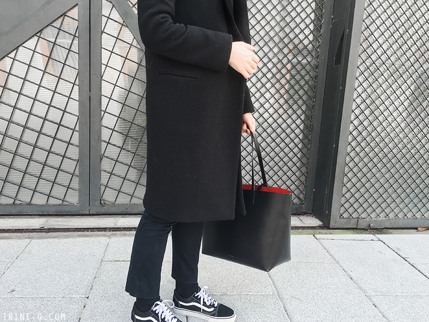 Trini | Claudie Pierlot black coat Vans old school sneakers
