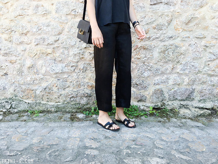 Trini   Acne Studios t-shirt Reformation pants Hermes Oran sandals