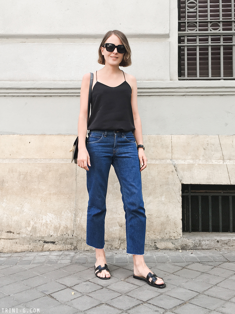 Trini | Tibi camisole Levis frayed jeans Hermes Oran sandals