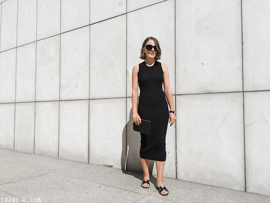 Trini | Acne Studios black dress Hermes Oran sandals