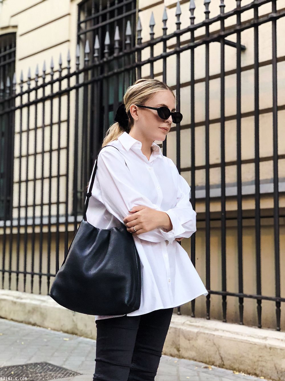 Trini | The Row shirt Balenciaga sunglasses Chanel flat slingbacks