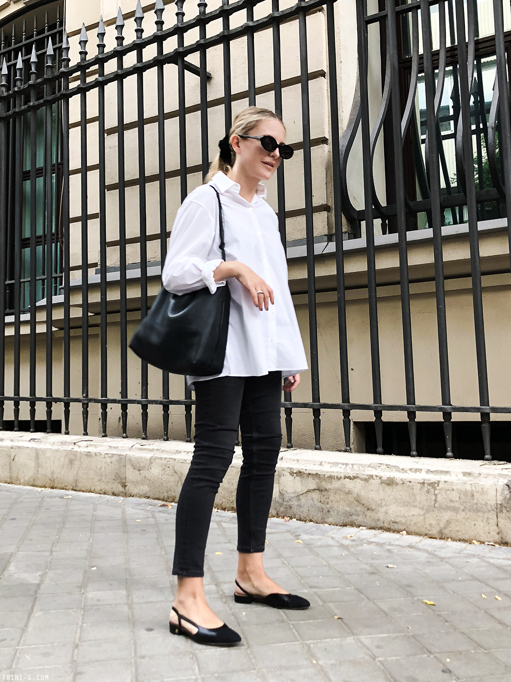 Trini | The Row shirt Balenciaga jeans Chanel flat slingbacks