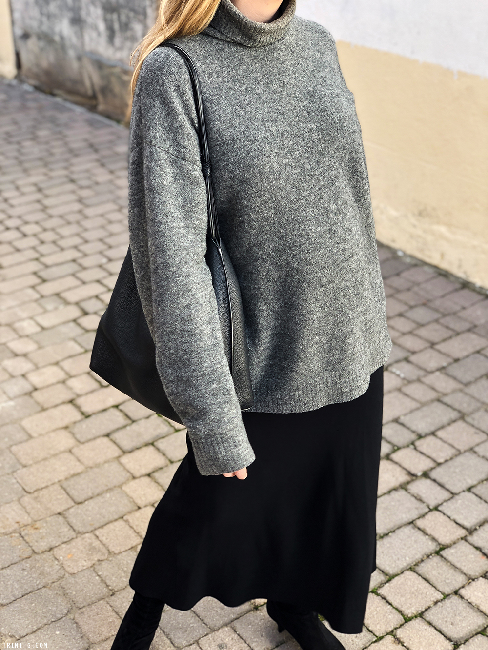 Trini | Balenciaga grey turtleneck The Row skirt