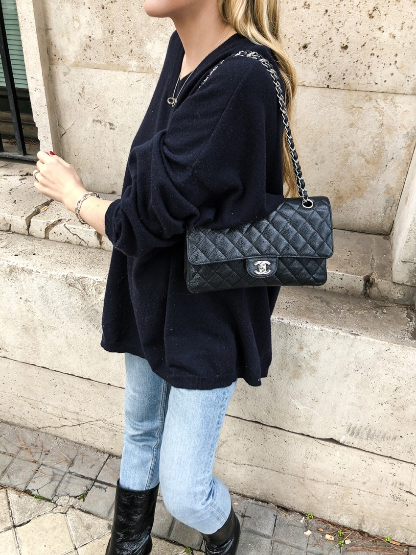 Trini | Loewe sweater Chanel boots