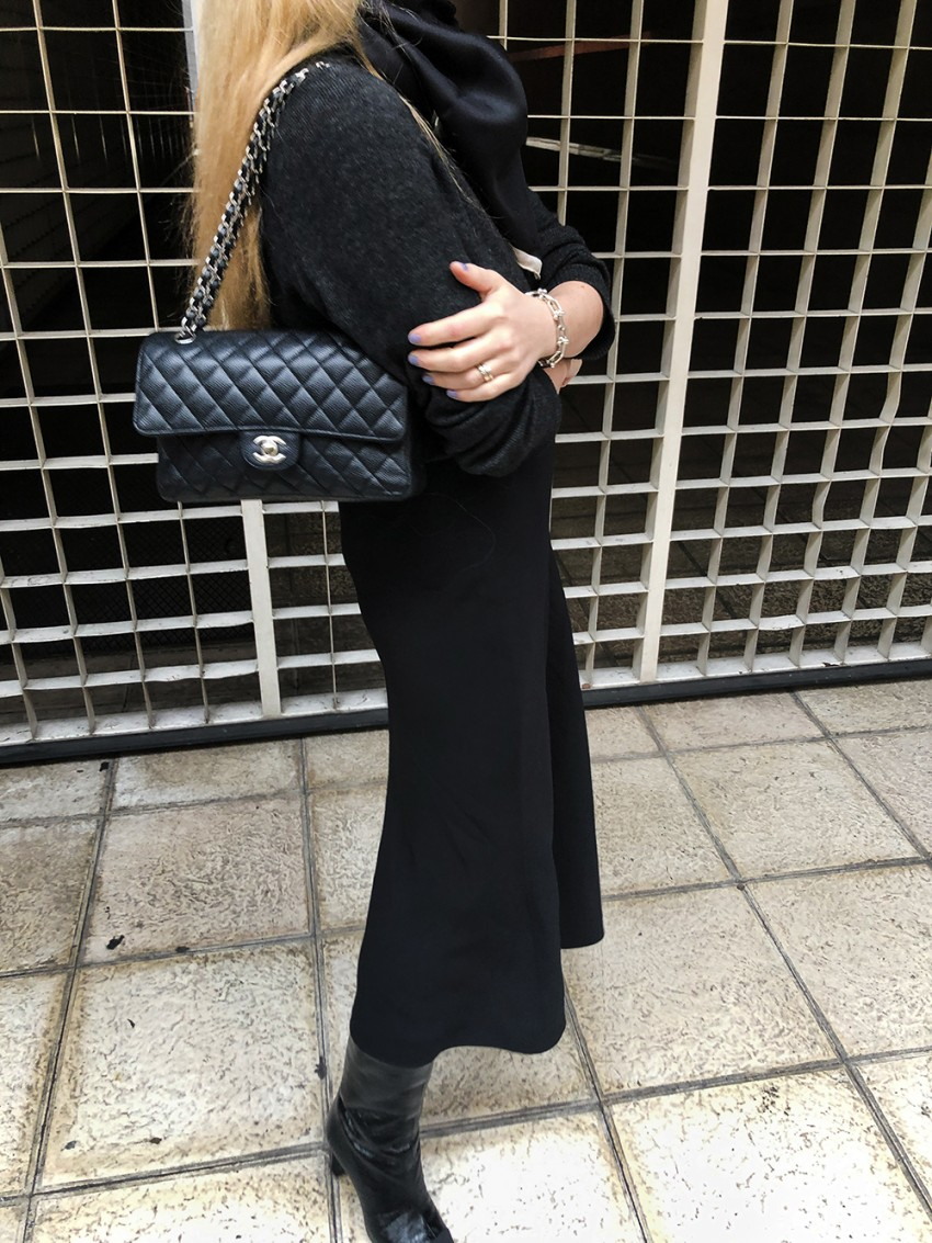 Trini | The Row skirt Chanel boots